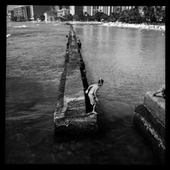 On The Edge... (Ralph Krawczyk Jr) Tags: ocean boy blackandwhite 6x6 film beach water swimming vintage hawaii jump sand snorkel oahu honoluluzoo madeingermany 120mediumformat kuhiobeachpark agfaclicki goteamholga ralphkrawczykjr