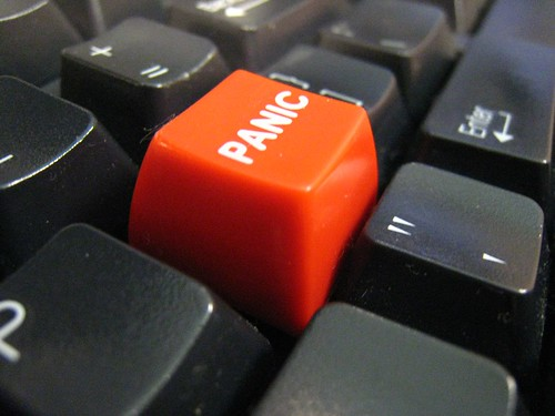 a keyboard with a red panic button installed