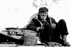 Retired homeless fisherman (pedrosimoes7) Tags: bw sun beach portugal homeless creativecommons onwhite sesimbra 73points mireasrealm 30faves30comments300views anawesomeshot bachspicgallery nuestrosancianos lightandaperturegroup however~itsstillmylife