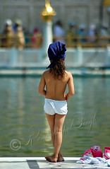 Is The Water Warm Enough (Raminder Pal Singh) Tags: india feet water look hair stand back kid bath bokeh wait ponder punjab amritsar position decision goldentemple stance decide fantasticdof
