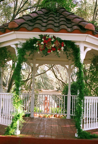pink white garland gazebo spray greens