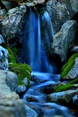 Blue waterfall (Anna (www.eprisephoto.com)) Tags: blue green nature water beauty rock waterfall moss nikon spiderweb magical breathtaking perfection naturesfinest slowwater d40 annamorris impressedbeauty superaplus aplusphoto kryger flickrphotoaward annakryger