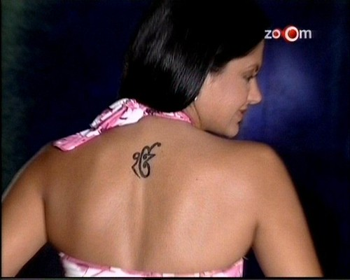 authorities for using a Sikh religious symbol on her body as a tattoo.
