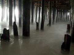 Cold water (mindgutter) Tags: ocean beach water sand under nj surreal atlantic creativecommons jersey boardwalk posts wildwood mindgutter