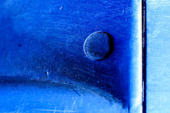 sleep with one eye open (♫ marc_l'esperance) Tags: blue shadow abstract macro texture playground metal canon circle eos raw metallic abstractart © scratches surface line equipment 10d abstraction minimalism curve nocrop uncropped minimalist allrightsreserved 2007 cml shading extensiontube canonef50mmf14usm abigfave colorphotoaward