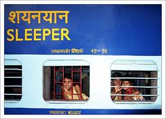 Sleeper Smiles (Christian Lagat) Tags: blue portrait woman india train children stencil women femme goa railway indianarchive grdigital enfant inde devanagari भारत ricohgrd karmali indiasong 50millionmissing