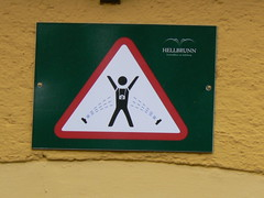 Free shower & camera wash. (delirious_equilibrium) Tags: travel sterreich salzburg sign warning austria funny europe palace tourist stickfigure stickfigureinperil trickfountains hellbrunn schlosshellbrunn touristindanger