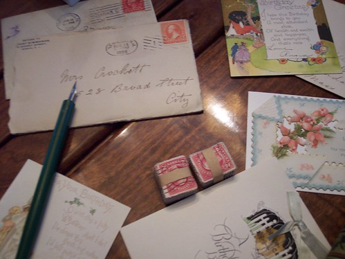 Vintage stationary, old letters, stacks of old stamps and an antique pen