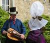 Norman folk costume coiffe hurdy gurdy