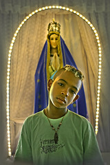 Illuminated... (carf) Tags: poverty light boy brazil boys saint brasil kids children religious hope kid community support child risk madonna faith religion illumination esperana social impoverished underprivileged altruism illuminated development prevention itanhaem atrisk nossasenhora ourlady mundouno jonathan2