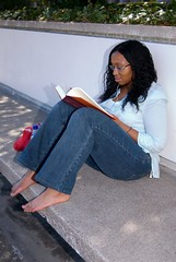 Studying - Planters (m00by) Tags: woman girl lady portraits concrete ipod books jeans barefoot albany why albanyny studying issa uofa greatdanes sunyalbany photoservice universityatalbany sunycampus torchpicks