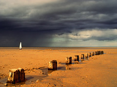 Rider on the Storm (BombDog) Tags: sky sun storm topf25 wow photography sand topf50 groynes windsail curated003 jonlucas jonathanlucas