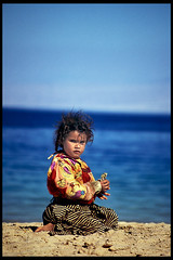 Small Beduin girl (BoazImages) Tags: travel blue red portrait people beach girl face topv111 sand colorful pretty desert redsea egypt nomads prettygirl sinai mideast indigenous beduin nomadic