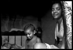 stepmother girl ( Tatiana Cardeal) Tags: boy brazil portrait bw film 2004 girl brasil magazine hope topf50 published photojournalism documentary forsakenpeople tatianacardeal pernambuco galleria cpt brsil stepmother centurys documentaire flickys pentaxspotimatic excellenceinsets popularphotographymagazine documentario