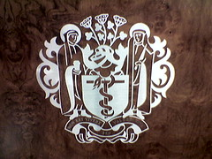Bizarre crest for a London institution (Tom Coates) Tags: shieldmonkey coatofarms crest design heraldry logo wood metalwork saint saints