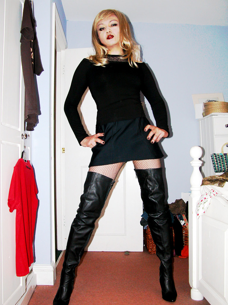 Transvestite wearing thigh boots