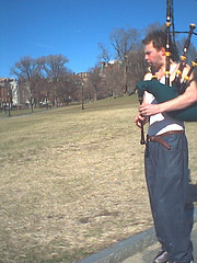 paying the piper (sweet lil' bunny) Tags: art boston commons bagpipe bagpiper music musician piper redfaced screech 02110