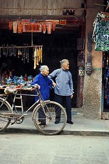 CHINA (BoazImages) Tags: china old blue bicycle topv111 women colorful asia guilin mao guangxi