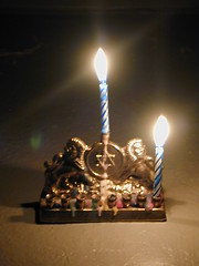 menorah with one candle lit