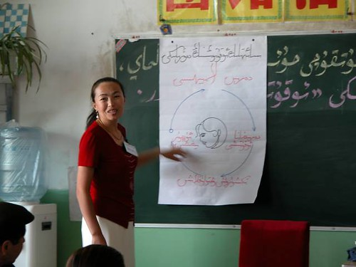 A Uyghur teacher in the classroom, image by pmorgan, some rights reserved.