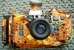 Olympus Stylus (jurvetson) Tags: camera disassembly mostviewed2004 topf25 topv9999 topf50 interestingness1 olympus stylus orange flex circuit topv11111 topf75