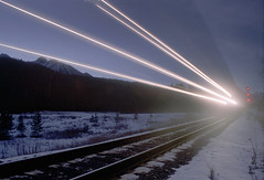 Lake Louise train (-Antoine-) Tags: longexposure railroad lake canada motion topf25 night speed train geotagged movement nightshot rail louise alberta lakelouise tccomp008 nuit mouvement vitesse rouleau geo:lat=514268 geo:lon=1161834 chemindefer antoinerouleau antoinerouleau
