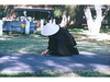 Nun saving a caterpillar (nospuds) Tags: mindfullnessday nun path