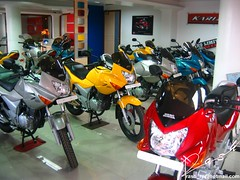 Colors (Rash) Tags: karizma motorcycle bike showroom charisma red yellow silver blue indian herohonda