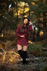 evening in the forest (Michael Kremsler) Tags: model girl portrait fashion shirt boots hat bokeh forest heide tree wood availablelight brunette eveninglight warm