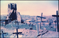 taos pueblo graveyard. taos, nm. 1999. (eyetwist) Tags: newmexico southwest film graveyard xpro crossprocessed ruins cross desert crossprocess aviation indian headstone pueblo 1999 ishootfilm adobe chemistry transparency marker positive taos process processed e6 indigenous emulsion c41 vps betterlivingthroughchemistry c41toe6 c41e6 eyetwist betterlivingthruchemistry negativetoslide contactforstockusage thisimagemaybeavailableforlicensecontactformoreinfo xproc41toe6 xproneg2pos