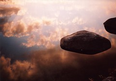 flying stone (rahen z) Tags: sunset sky 15fav reflection film water stone clouds 1025fav tokyo iso200 olympus 100v10f 2550fav zen xa   zuiko sora  olympusxa tamagawa  konicaminoltacenturia