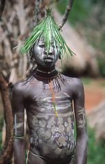 Surma boy #1 (foto_morgana) Tags: ethiopia tribes surma africa kibish ethnic boy facepainting bodypainting hat