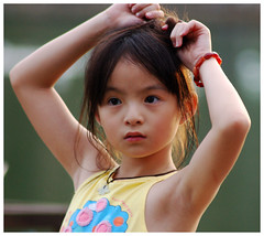 Just a girl, not yet a woman... (ButterCupMe) Tags: park girl singapore pretty pasirristownpark tc28closeup