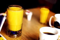 A matter of perspective (yan-san) Tags: orange juice coffee glass mug
