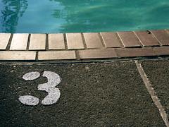 three_feet (sillydog) Tags: 2005 blue 3 brick water pool topv111 oregon danger warning portland concrete three topv333 calendar label august number 50100fav fv10 tres information hillsdale