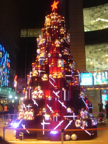Shanghai, China - Christmas tree made of presents in Grand Gateway shopping  center (Xujiahui