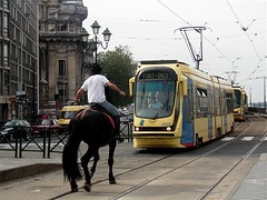 high noon in Brussels (malidinapoli) Tags: street brussels horse trois three weird crazy verrckt belgium belgique absurd ttc bruxelles tram streetlife riding louise tres abc highnoon brssel tre brussel cavallo pferd brilliant fou strassenbahn drei belgien confrontation drie louiza notalways