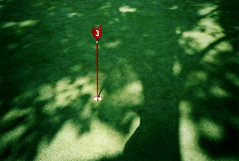 mini golf (flybutter) Tags: shadow red 3 tree green catchycolors golf three lomo lomography saveme3 deleteme10 minigolf fave puttputt lomographs alexisscherl flybutterphoto flybutter