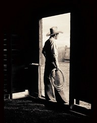 Totem in sepia (Big Sky Nik) Tags: man lariat doorway western cowboy