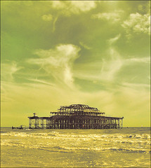 . The Ruins - Part 1 . (3amfromkyoto) Tags: uk sea england sky west 2004 water clouds sussex pier ruins brighton waves yacht rusty surreal august east westpier foam rusted remains corroded firedamaged esussex kioskrip 3amfromkyoto flickr:user=3amfromkyoto