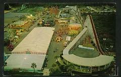 Twilight Time at Miracle Strip Amusement Park, Panama City Beach Florida. 1970's post card (stevesobczuk) Tags: seaside twilight florida amusementpark rollercoaster 1970s midway panamacitybeach starliner miraclestrip redneckriviera us98 frontbeachrd
