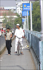 cultural exchange (Meghna Sejpal) Tags: bridge boy girl cycle meghna pca thepca bsbstory bollywood19701980