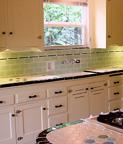 Glass subway tile backsplash, custom under cabinet lighting