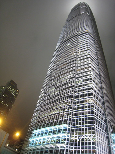 Hong Kong at night - looking up at a very well lit building