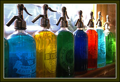 Pour Me a Rainbow (fotofantasea) Tags: travel blue light red stilllife brown white reflection green water glass yellow closeup composition colours dof angle bottles silverton interior perspective drinking australia roadtrip frame newsouthwales 19 ambience blueribbonwinner abigfave abigfav anawesomeshot goldenphotographer superhearts auselite