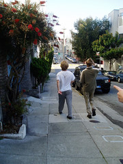 a photo of my friends walking down a street in San Francisco