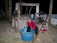 Nancy washing clothes by the well at the abandoned homestead