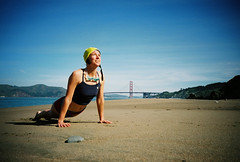 upwards dog? (lomokev) Tags: sanfrancisco california beach sport yoga female lomo lca lomography fuji lomolca fujireala goldengatebridge swimmer chinabeach fitness reala lomograph jene fujisuperiareala jenniferellison  deletetag sanfrancisco2007 file:name=070330lomolca35 rota:type=landscape rota:type=showall rota:type=composition rota:type=portraits roll:name=070330lomolca