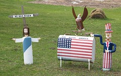 """He Has Risen"" & ""God Bless America"" Lawn Ornaments, On Route 31 (Just North Of Beulah, MI) (takomabibelot) Tags: folkart michigan baldeagle americanflag christianity godblessamerica beulah patriotism unclesam jesuschrist irvingberlin benziecounty hehasrisen paschalgreeting mistateroute31"