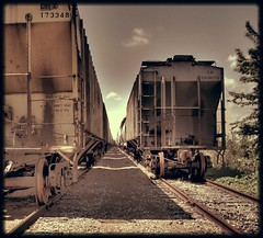 (K e v i n) Tags: railroad sky photoshop tracks trains cairo blended aviary hdr highdynamicrange railroadtracks desaturate cairoil southernillinois photomatix cairoillinois tonemapping kodakz760 twotrains 2trains